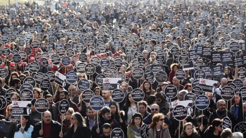 Protesters march to Agos newspaper office during a demonstration to mark the seventh anniversary of the killing of Turkish-Armenian journalist Hrant Dink in Istanbul