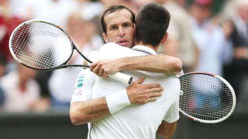 062514-TENNIS-Radek-Stepanek-of-Czech-Republic-hugs-Novak-Djokovic-PI.vadapt.955.medium.0