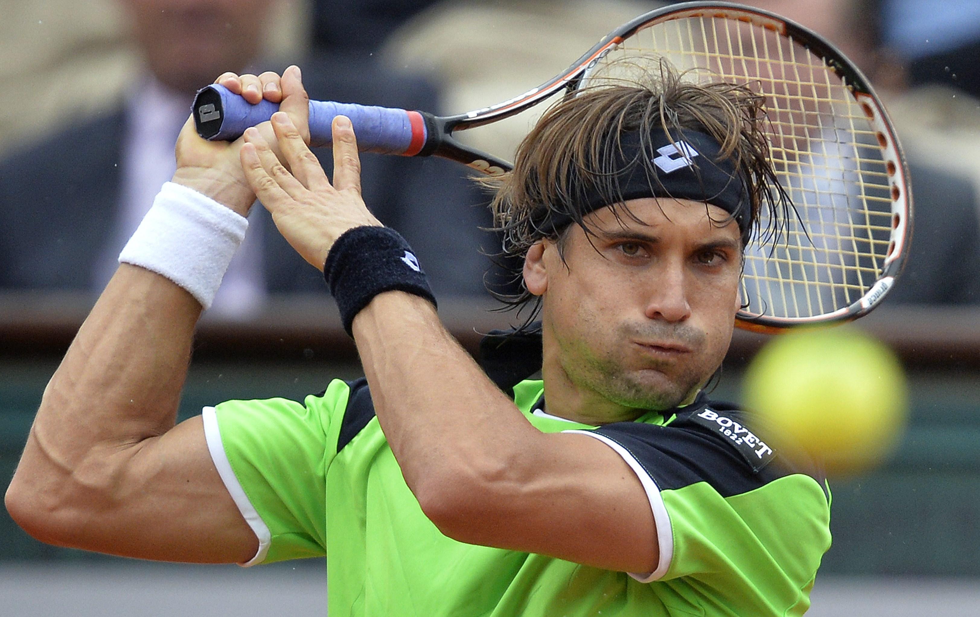 TOPSHOTS Spain's David Ferrer returns a