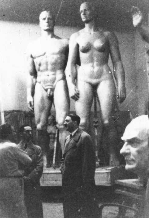 Adolf Hitler in the workshop of the sculptor Josef Thorak, with Thorak's bust of Atatürk behind him, Munich, February 1937
